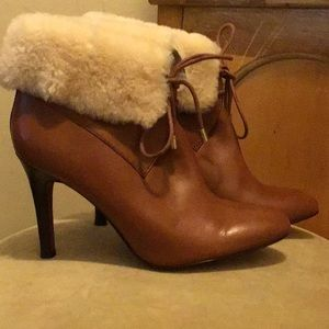 Camel colored fur lined coach ankle boots.